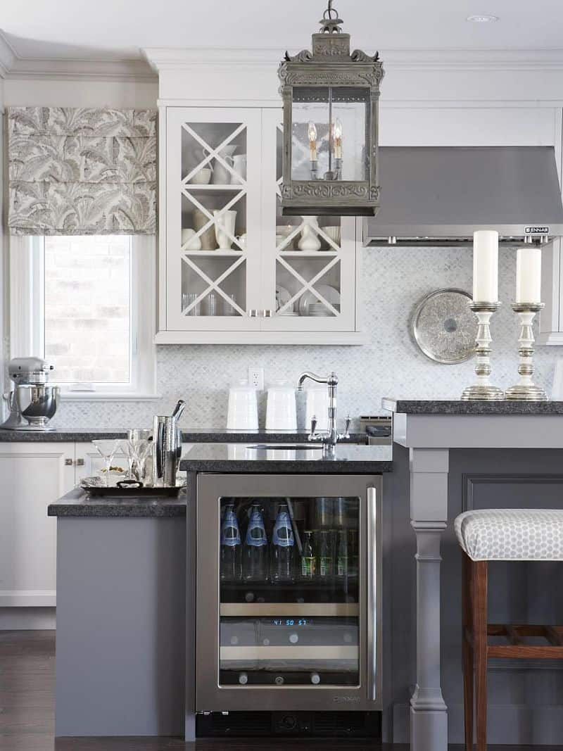 Gray Kitchen with honed granite countertops and Carrara marble mosaic backsplash