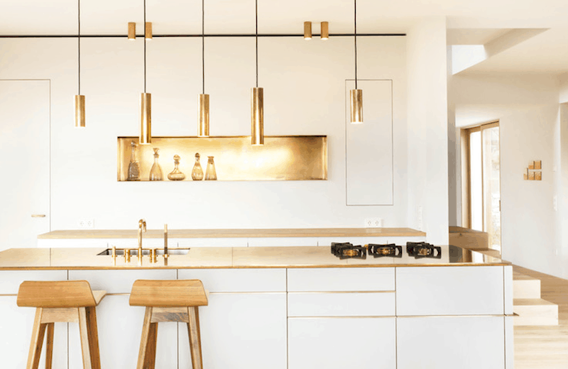 Metallic accents in minimalist kitchen