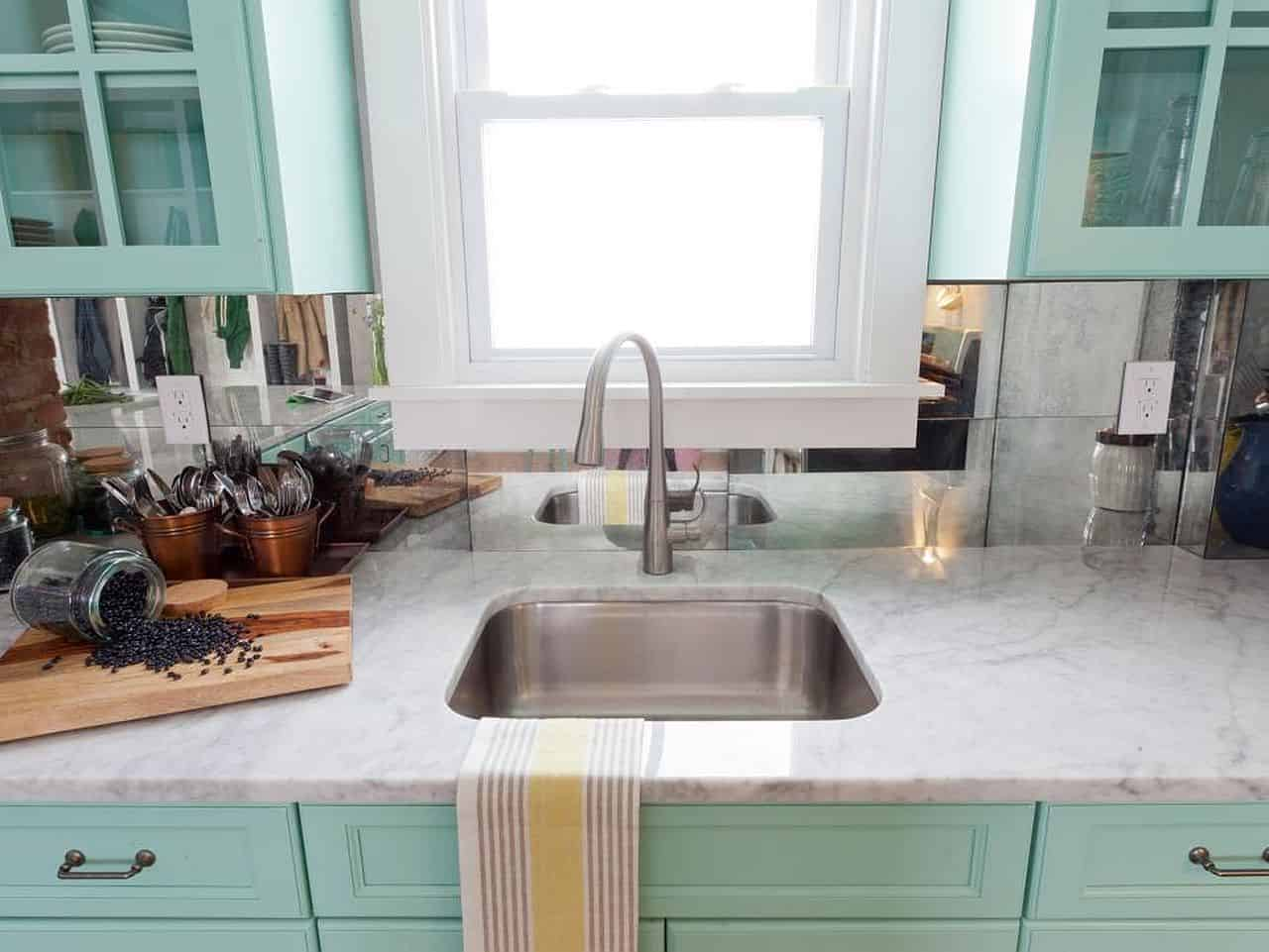 Mint with Carrara Marble countertop and Mirrored tile backsplash