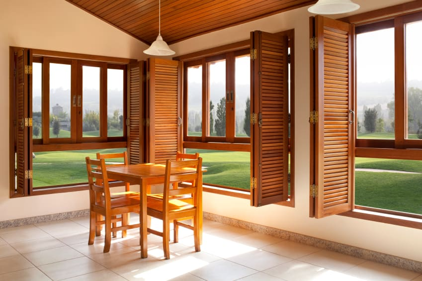 View in gallery Natural wood shutters