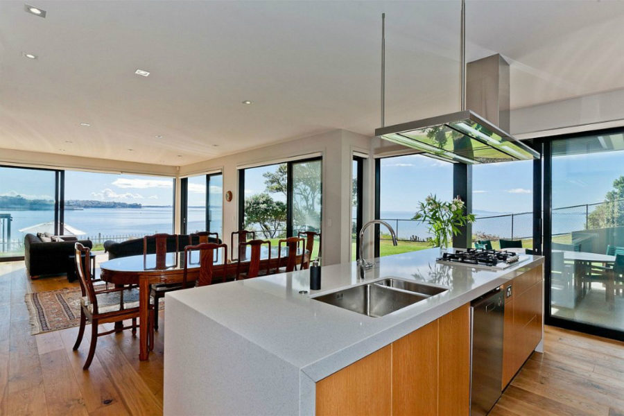 Open layout kitchen and dining room open up to the seaside views