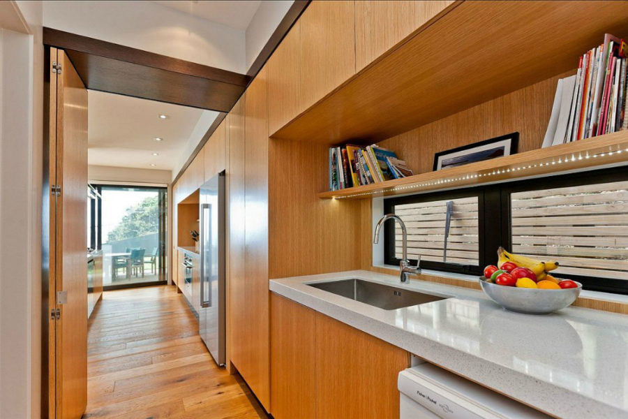 Wooden cabinetry complement the flooring