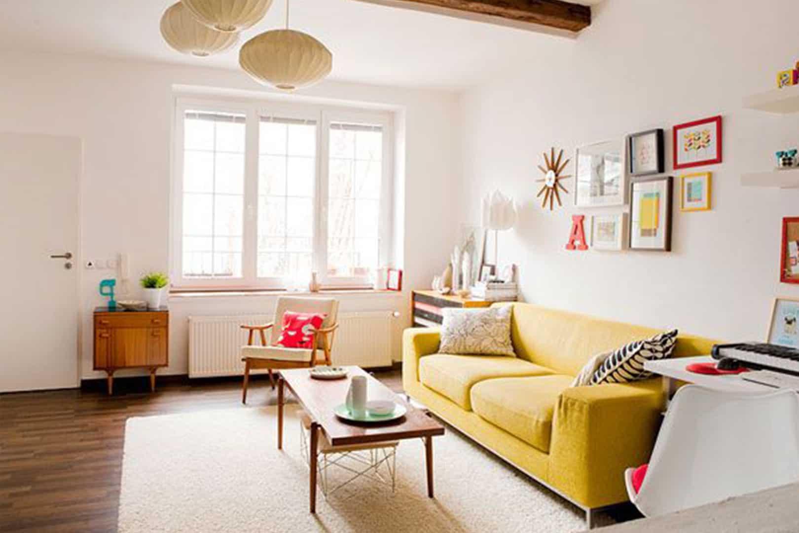 beautiful-simple-modern-living-room-design-ideas-yellow-modern-sofa-brown-laminated-wooden-table-white-wall-brown-laminated-wooden-floor-brown-laminated-wooden-cabinet-white-wall-white-rug-glass-windo