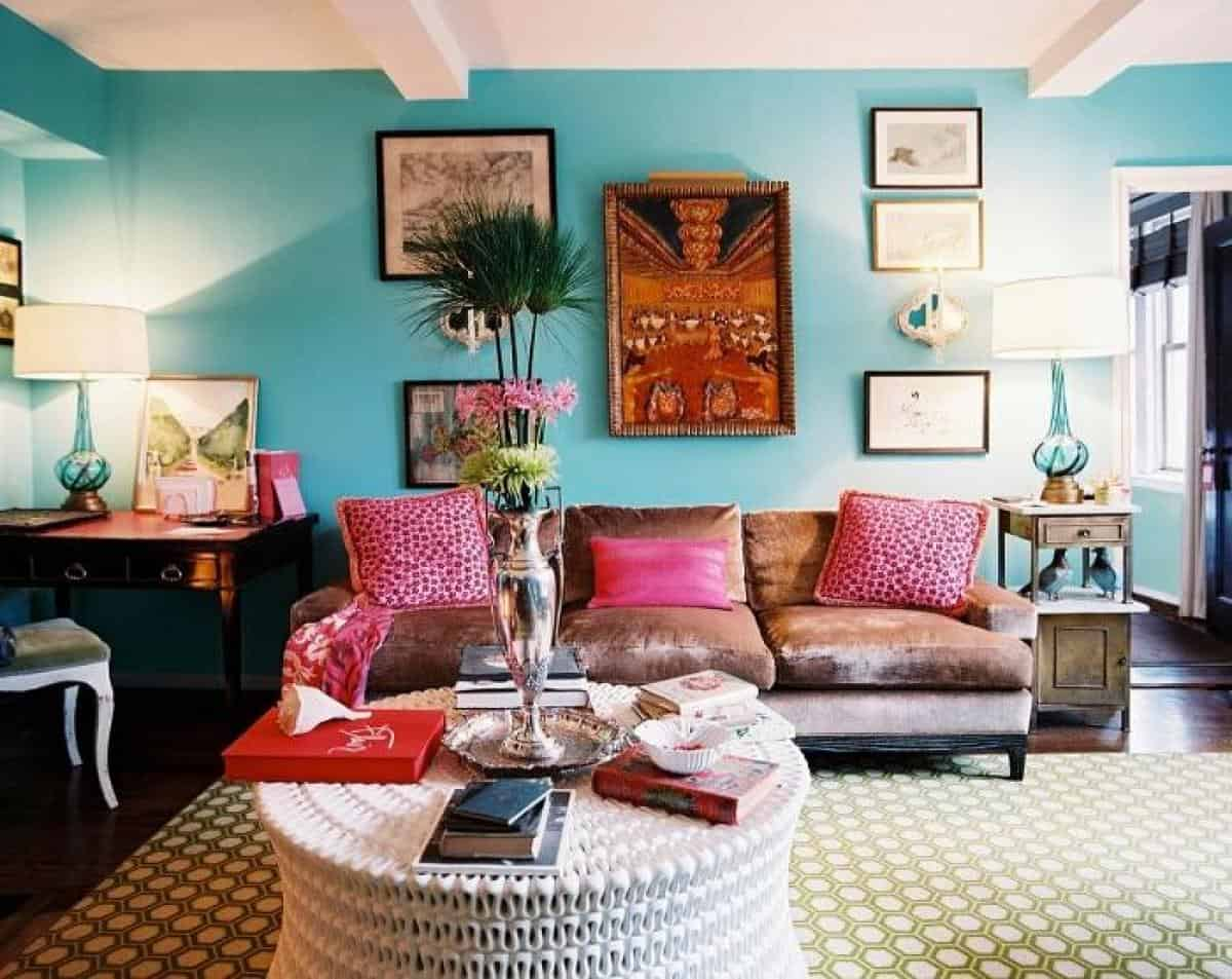 blue-living-room-walls-with-brown-sofa-and-pink-pillows-with-arch-lamp-and-also-good-interior-decor