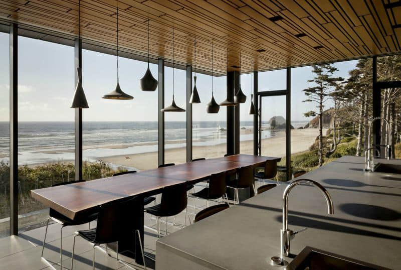 A dining area features a collection of pendants lights