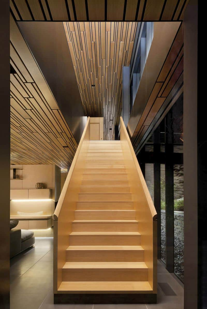 A wooden staircase connects the ground and first floors