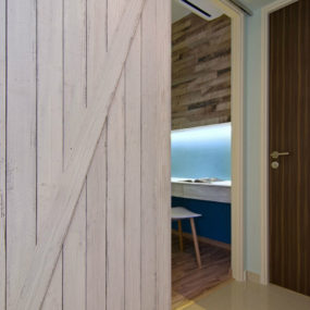 Barn doors in a Beach Home in Singapore 285x285 Bring Some Country Spirit to Your Home With Interior Barn Doors