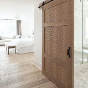 Bathroom barn door by Kelly Deck Design 285x285 Bring Some Country Spirit to Your Home With Interior Barn Doors
