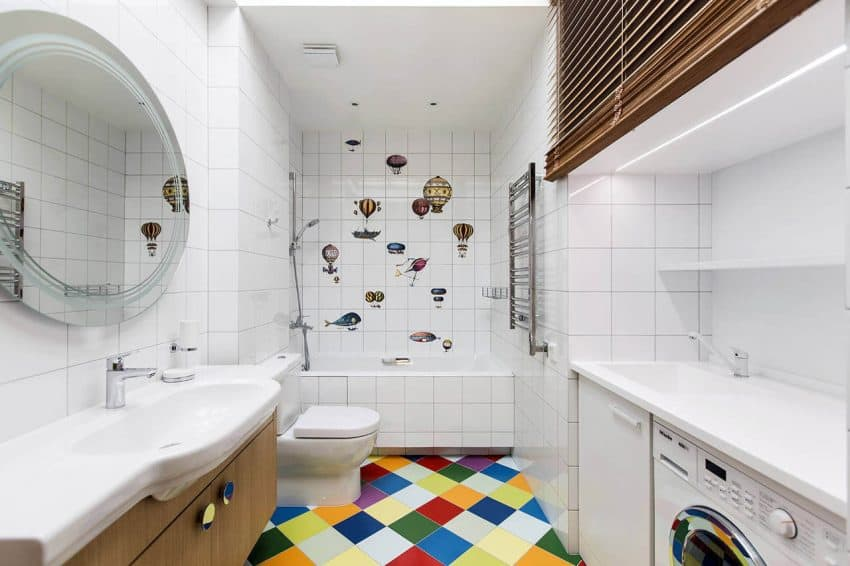 Bathroom with laundry area and graphic stickers