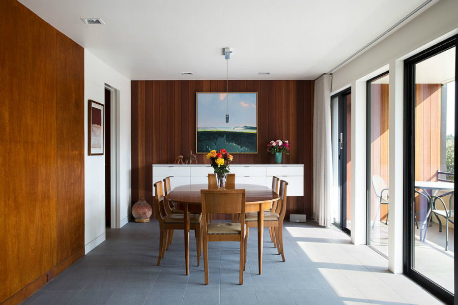 Beautiful dining room is set close to glazed balcony doors to enjoy plenty of natural light