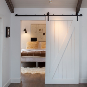 Bedroom barn door 285x285 Bring Some Country Spirit to Your Home With Interior Barn Doors