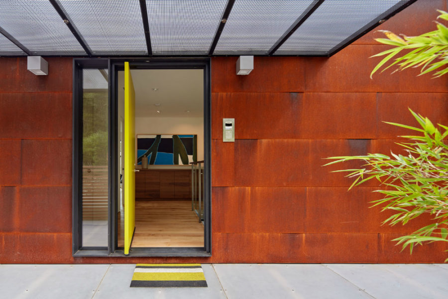 Bright doors makes for an eye catchy accent in a red rust metal siding