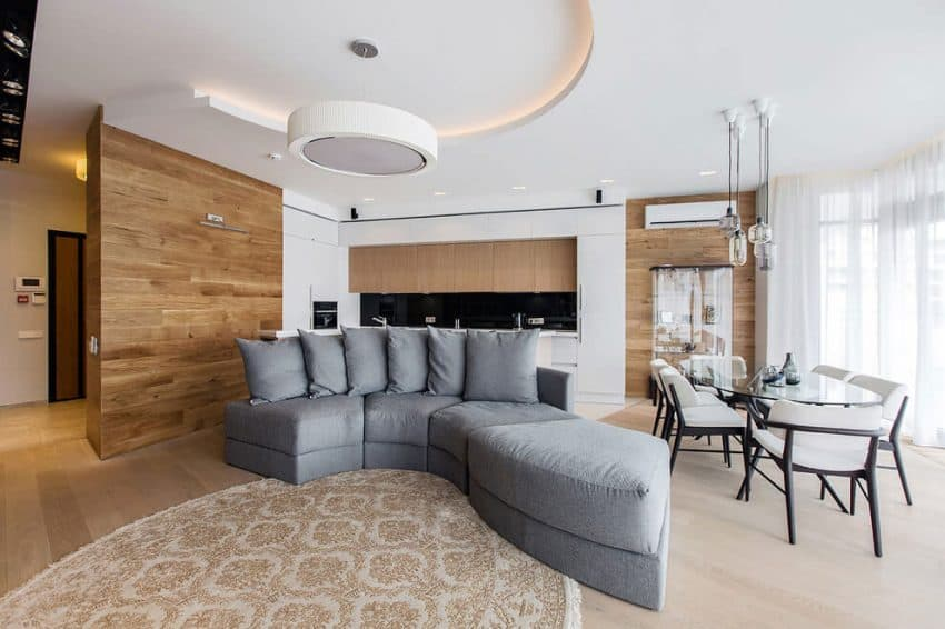 Curving sofa and dining room view
