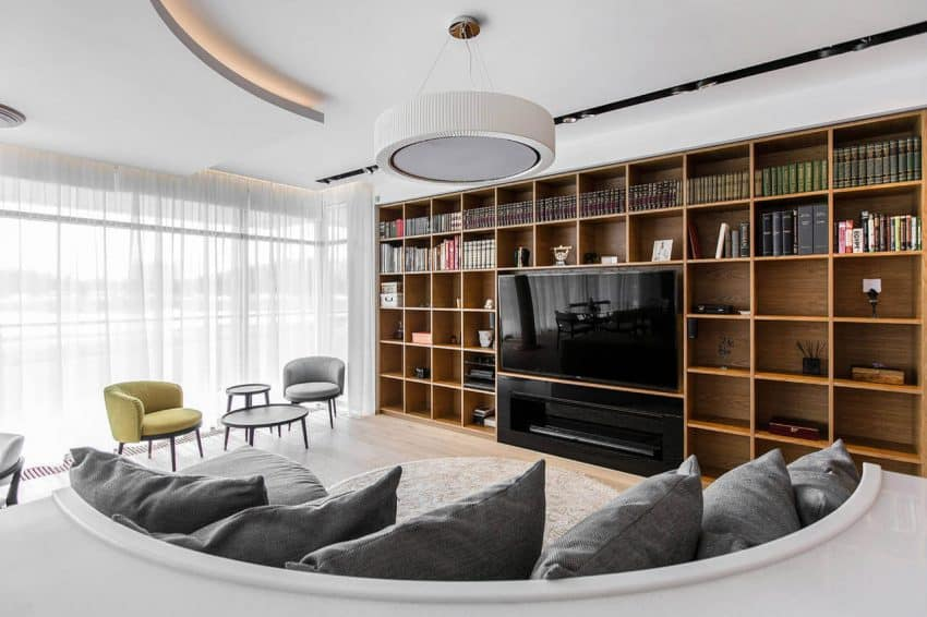 Curving sofa and shelving entertainment unit