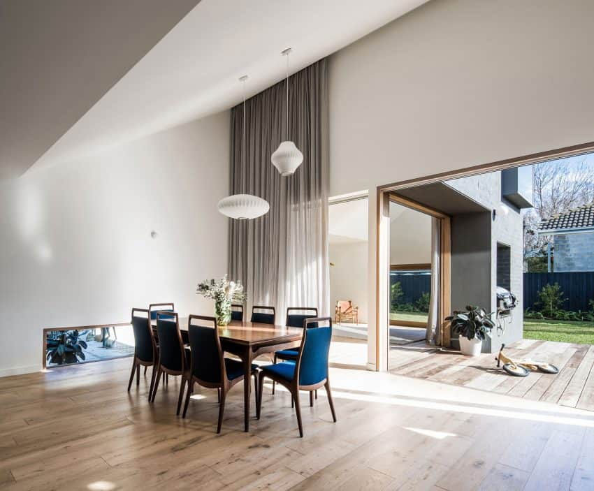 Dining area features amazing blue chairs and creative lights