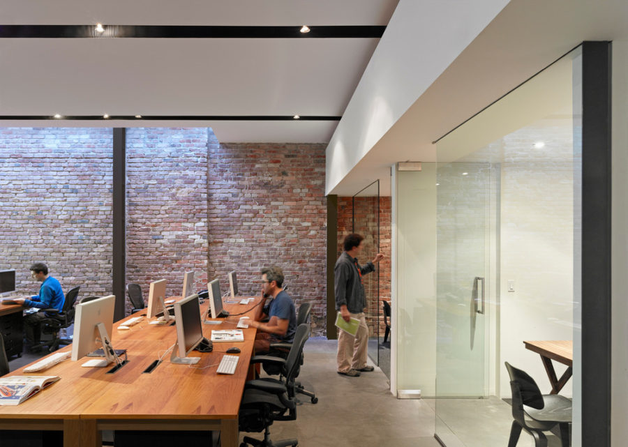 In the main room there is an open plan office with shared desks