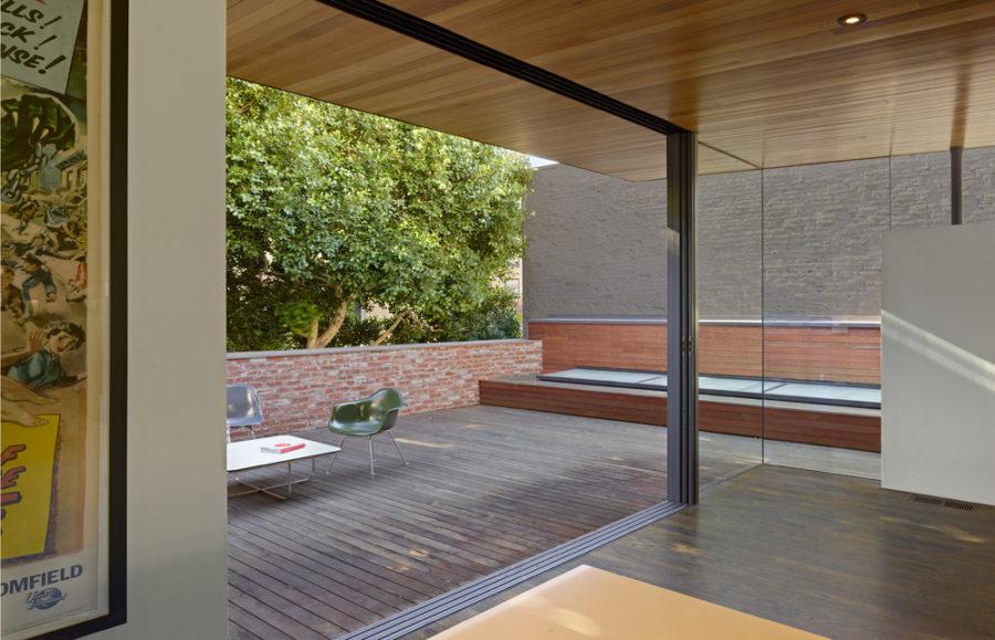 Indoor/outdoor room opens up to the wooden terrace