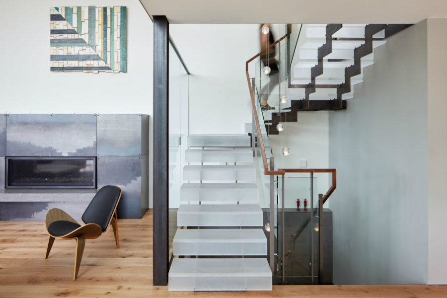 Inside the glass staircase allows the interior to be light and airy