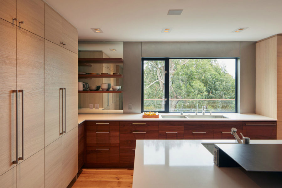 Kitchen features a huge window and plenty of storage space