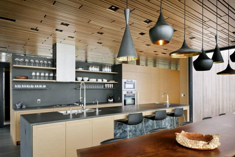 Kitchen features both wooden cabinetry and trendy floating shelves