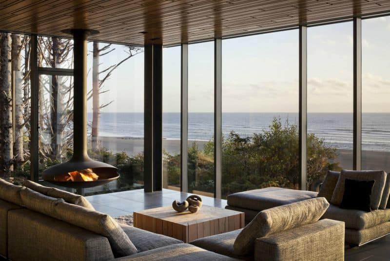 Modern fireplace brings warmth and conziness to the room with glazed exposed walls