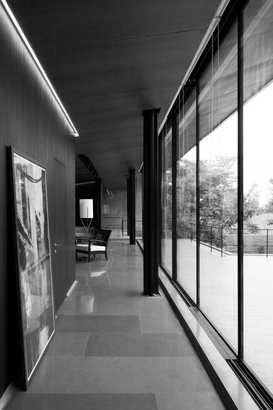Narrow hallways will never feel claustrophobic with glazed walls