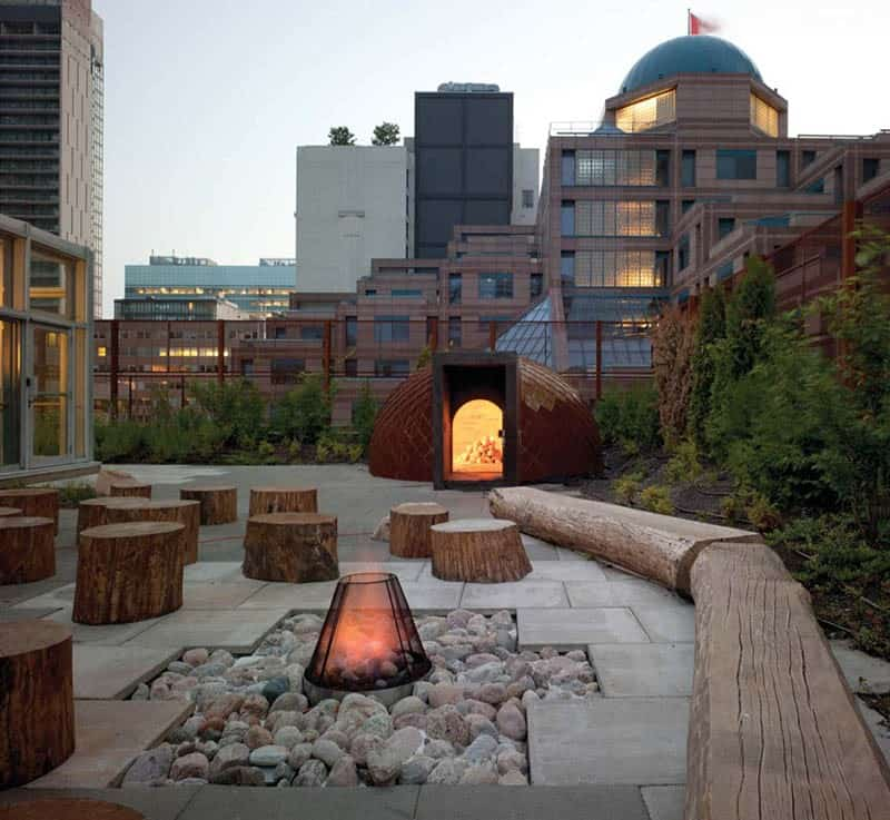 Rooftop fire pit by Scott Torrance Landscape Architects