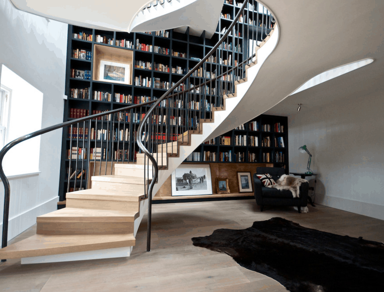 View In Gallery Swirling Bookcase Stairwell