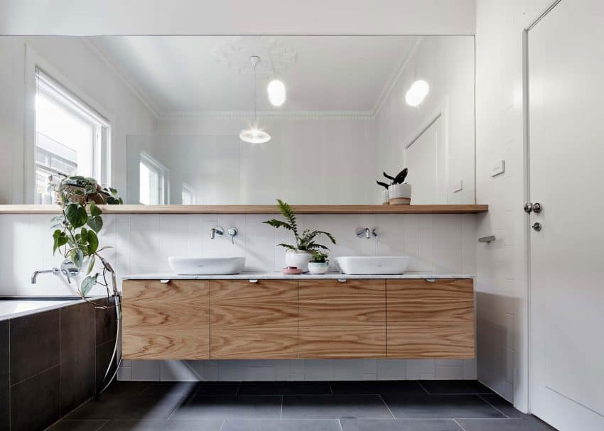 Tiled bathroom with a wooden floating vanity