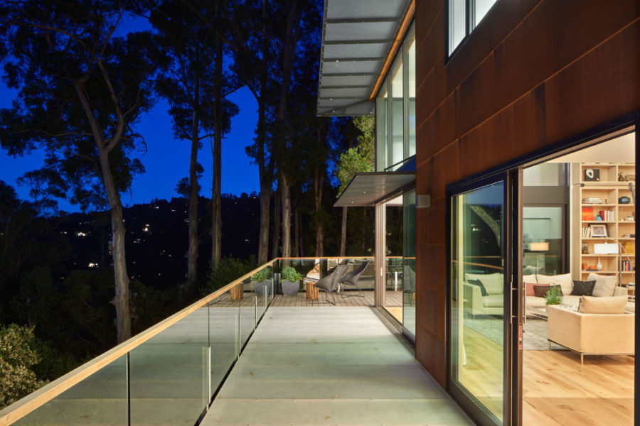 Top level balcony's glass railings allow unobstructed views of the green locale