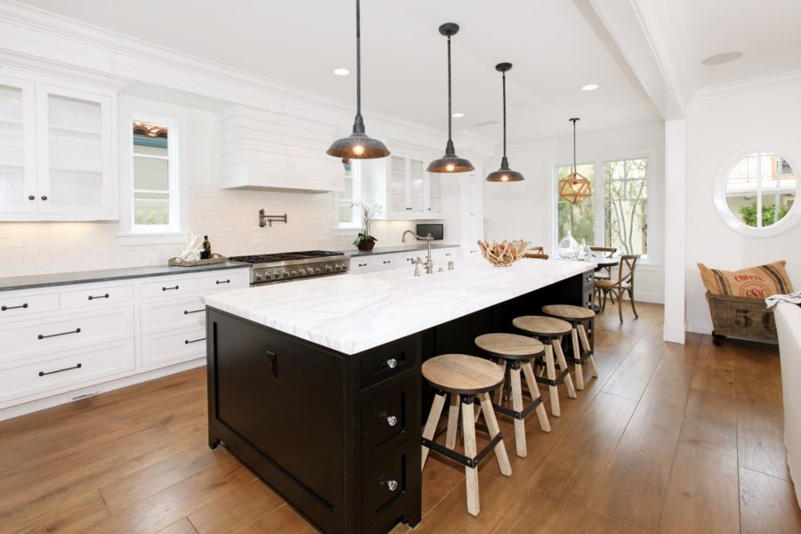 View in gallery Two-Tone-Kitchen-Cabinets-Black-and-White-Picture