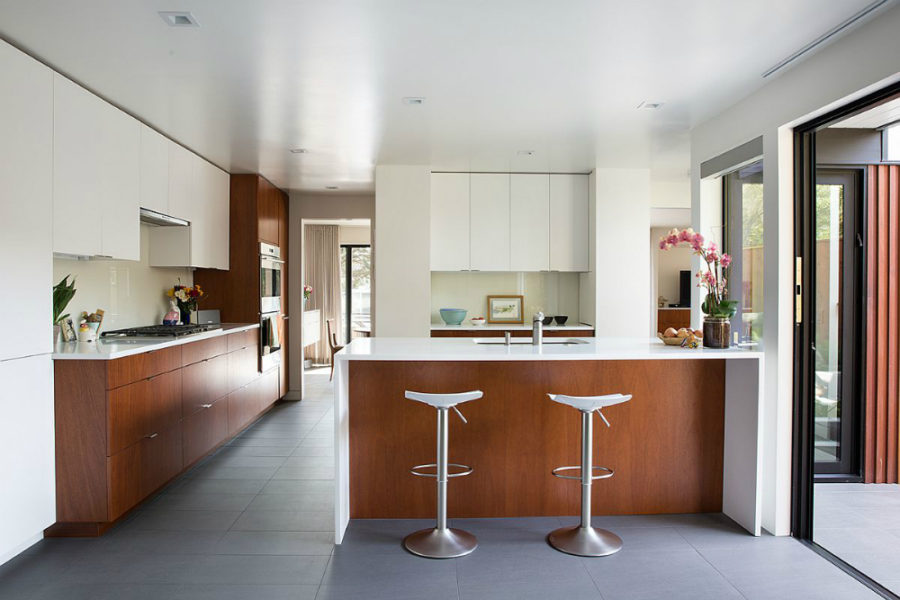 White and mahogany make for a stylish kitchen design 900x600 1962 Eichler Home Remodel in San Francisco by Klopf Architecture