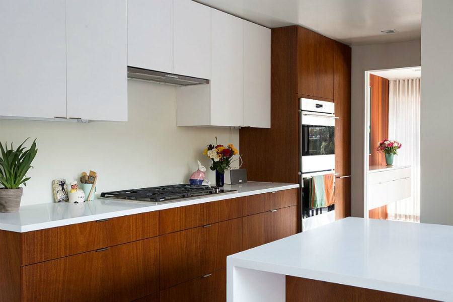 White kitchen countertops contrast nicely with wooden cabinets