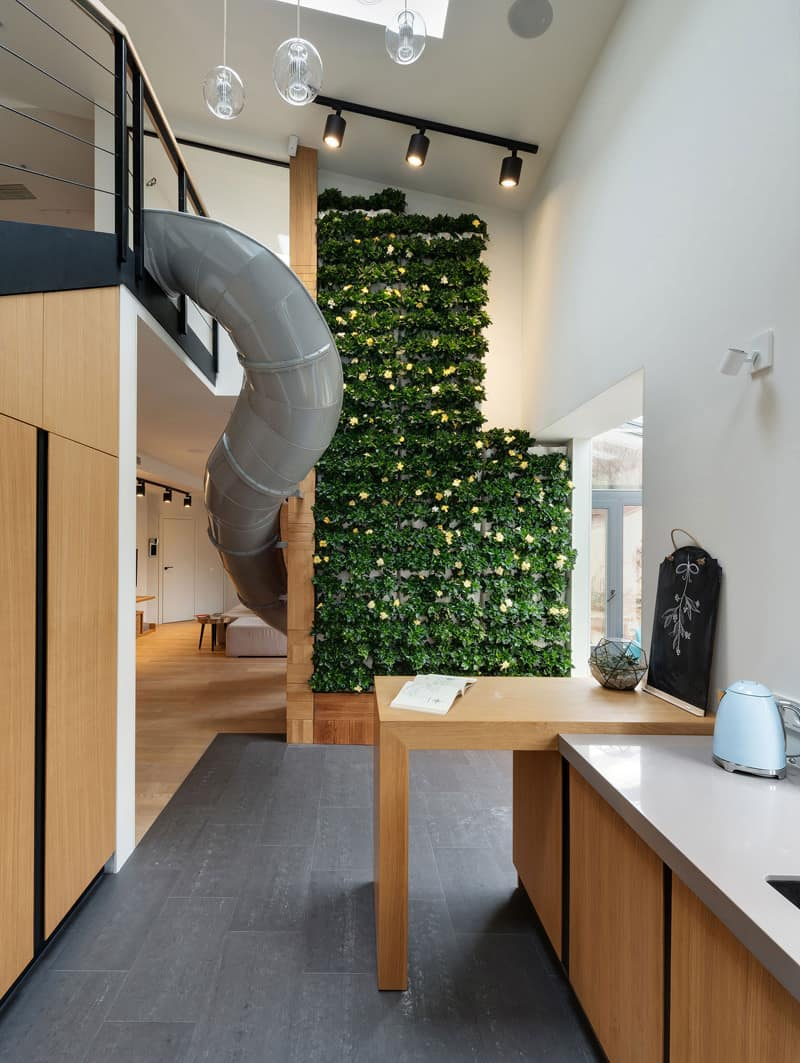 Apartment with slide and vertical garden