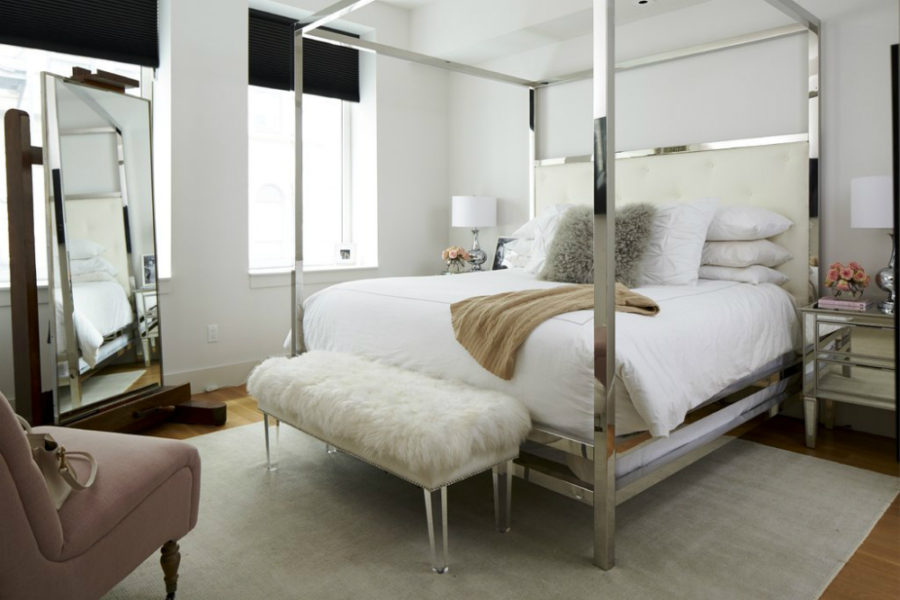 Ariel of Something Navy bedroom makeover features a mirrored canopy bed