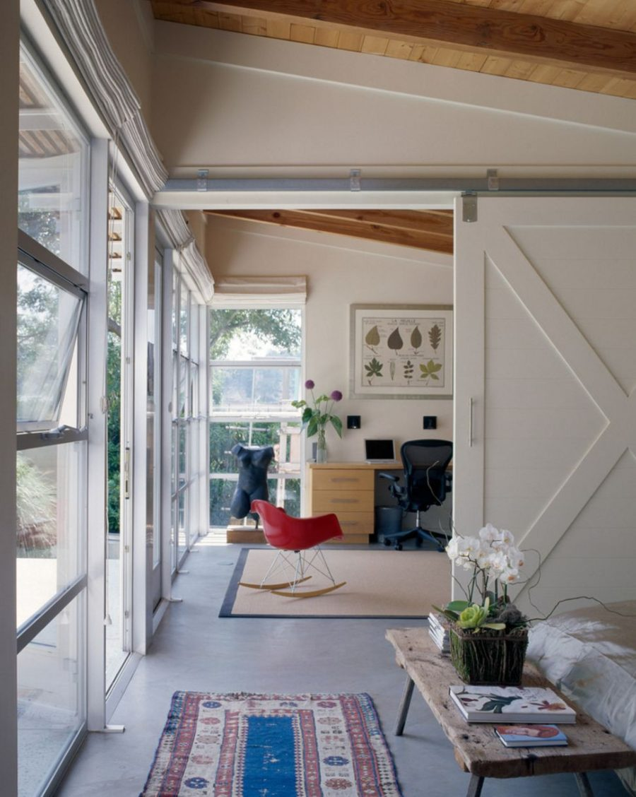 Barn doors used to divide large spaces 900x1128 Bringing Sliding Barn Doors Inside