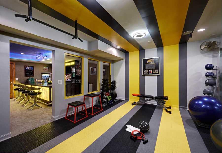 Basement home gym and bar by Vonn Studio