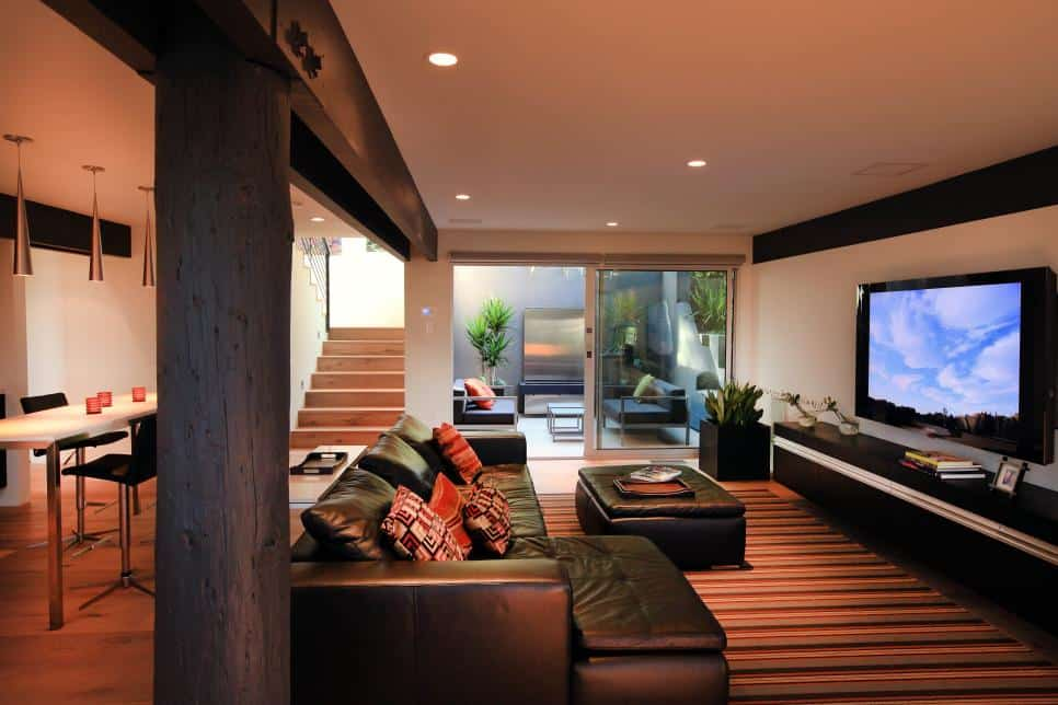 Basement media room with an inner courtyard by Bill Bocken