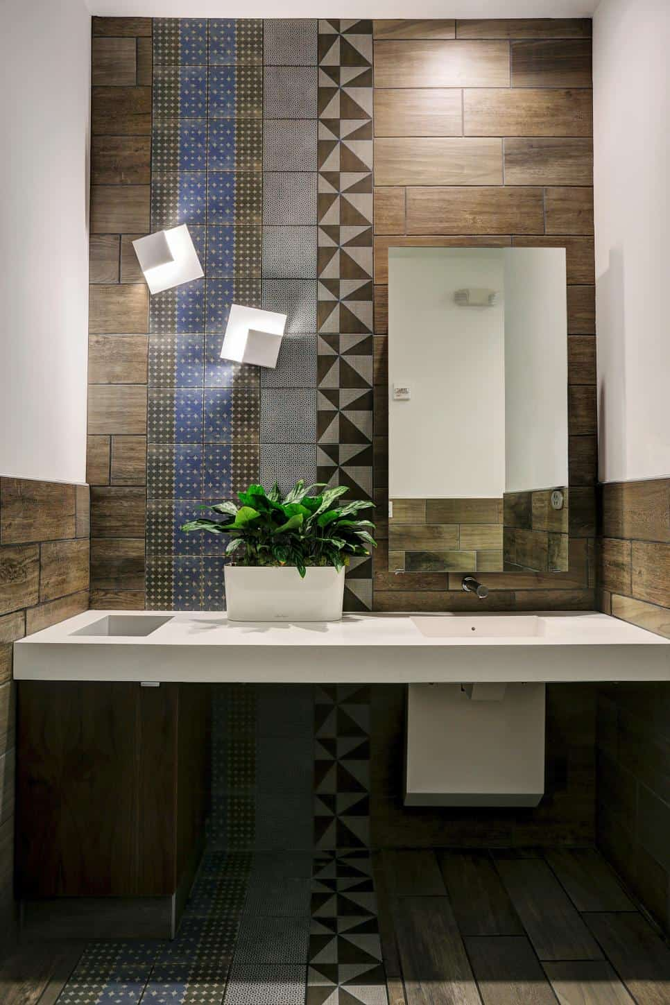 Bathroom accent wall in wood look tiles by Gin Braverman