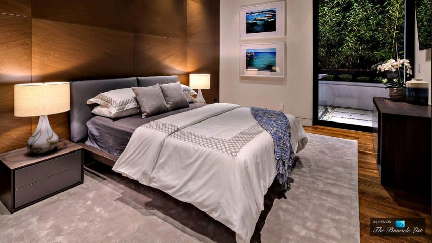 Bedroom in contemporary style features wooden panelling