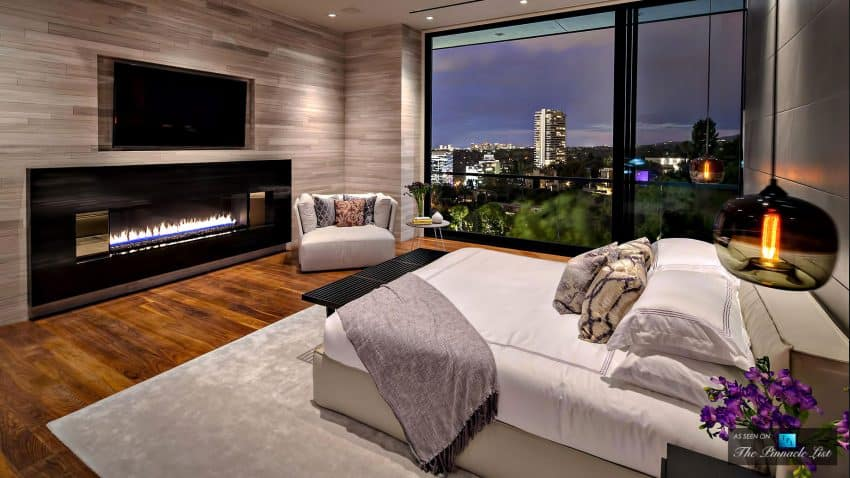 Bedroom with a fireplace opens up to the views