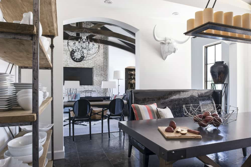 Breakfast room with a leather couch and a candle chandelier