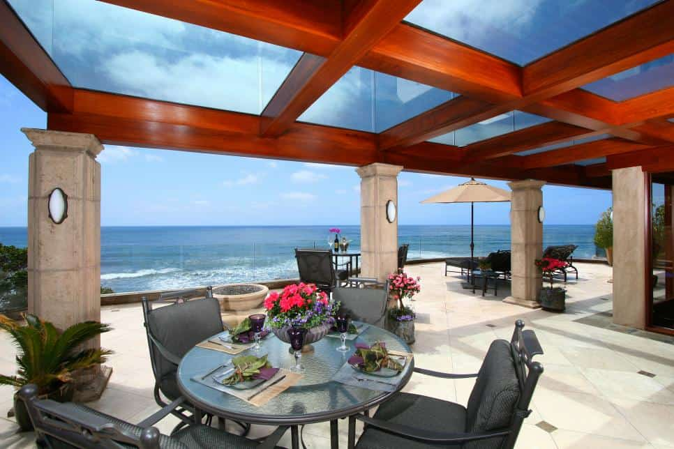 Covered patio with a glass sun awning