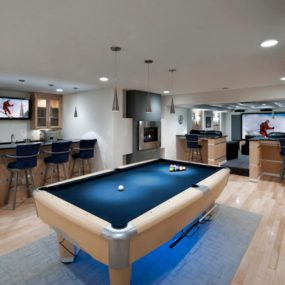 Entertainment basement with fireplace area 285x285 Bright Basement Remodelling Ideas