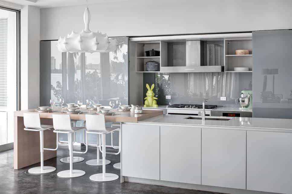 Grey glass backsplash by  [STRANG] Architecture