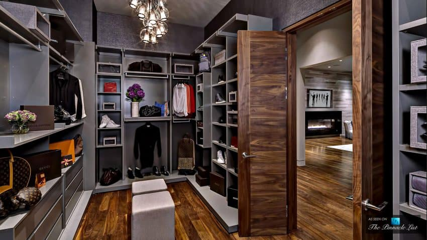 Highly organized wardrobe is dressed in wood