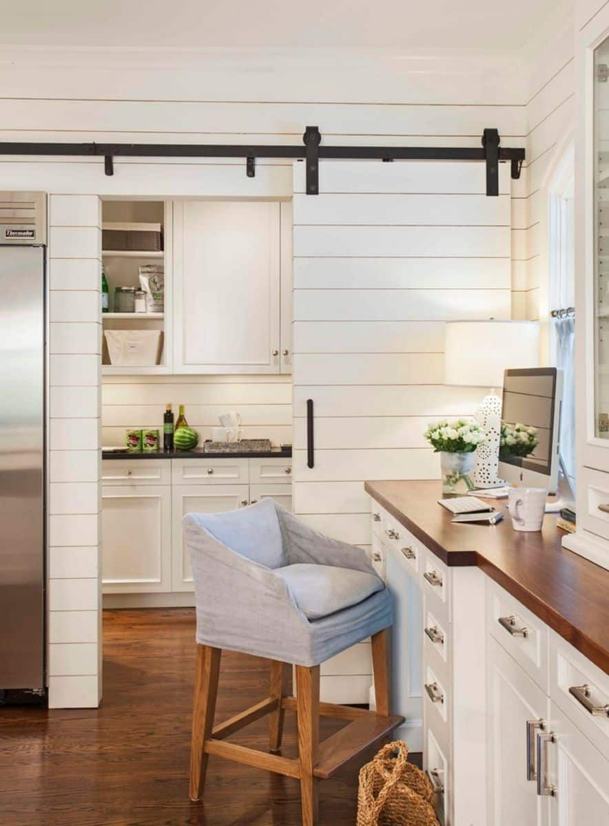 Kitchen office divided by a small barn door