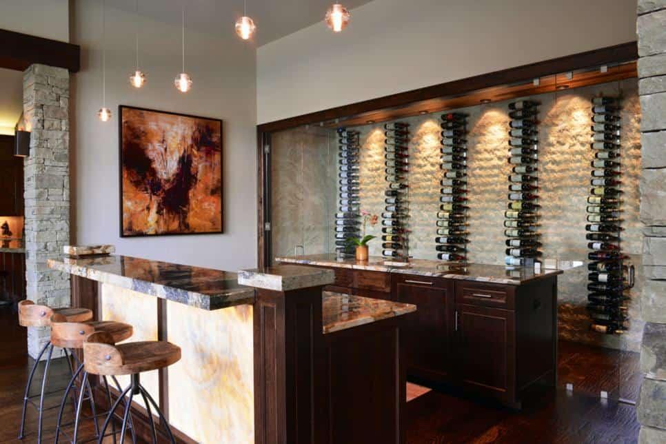 Luxurious basement bar design by AVID Associates