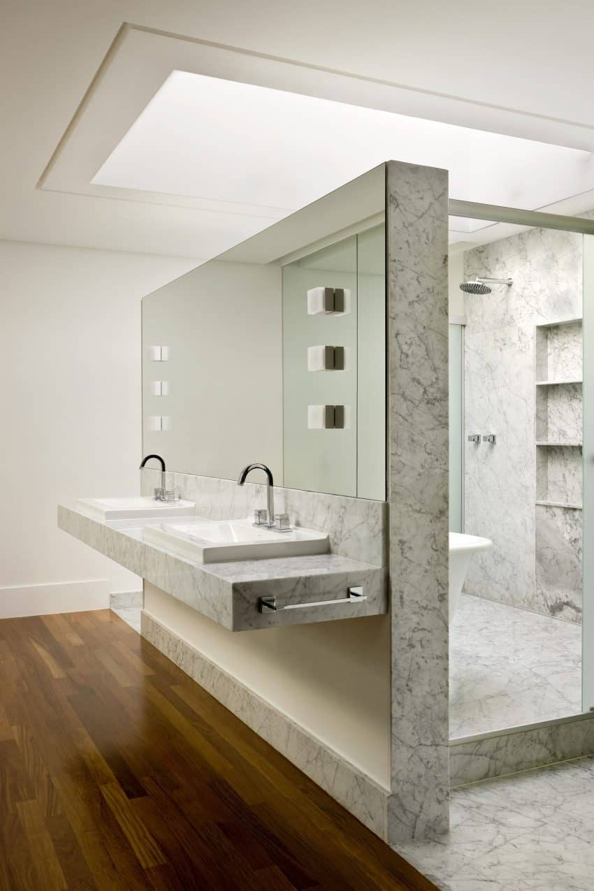Marble-clad shower hides a freestanding tub