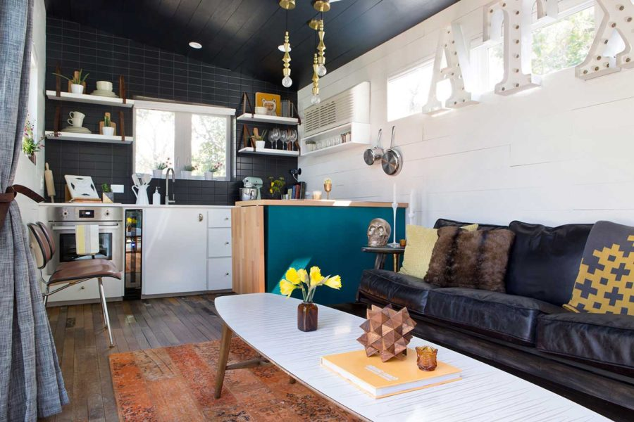 Mid-century Marfa tiny house living and kitchen